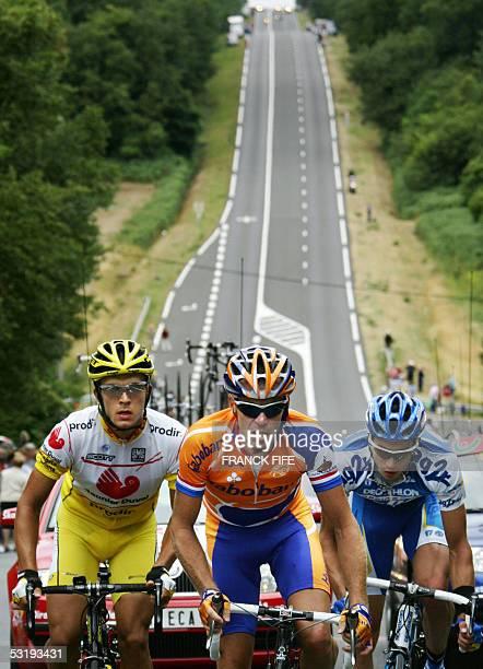 La Chataigneraie, France: Frenchman Nicolas Portal , Dutch Erik Dekker and Spaniard David Canada ride uphill during their breakaway in the third...