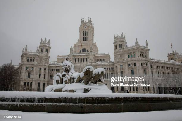 La Cibeles sculpture is covered with snow during heavy snowfall on January 09, 2021 in Madrid, Spain. Spain is on red alert for a second day due to...