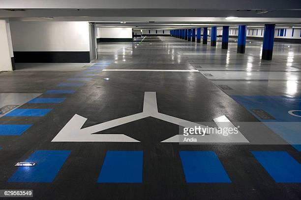 """La Ciotat . June 2009. Car park / parking lot """"Vinci Park, Vieux Port"""". Empty level. Course marked with white arrows painted on the ground, means of..."""