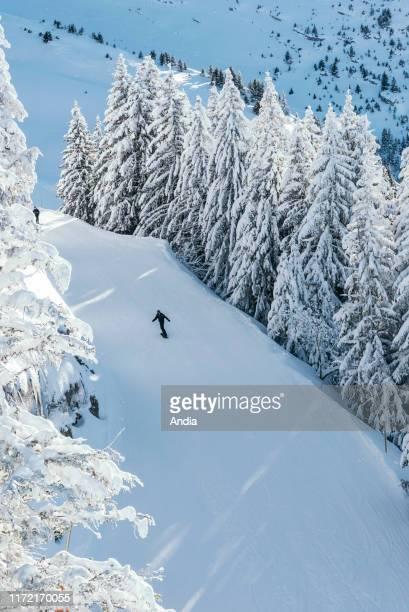 landscape on the upper ski runs with a snowboarder alone