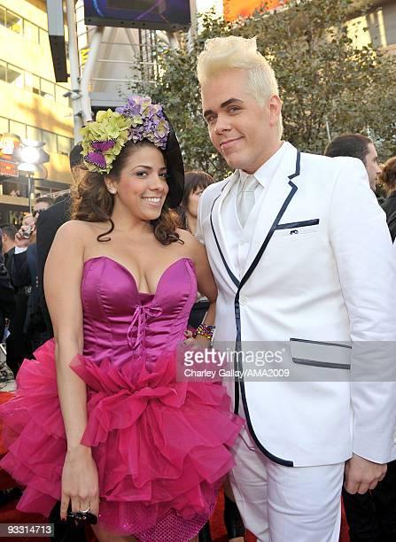 La Coacha and Perez Hilton arrive at the 2009 American Music Awards at Nokia Theatre LA Live on November 22 2009 in Los Angeles California