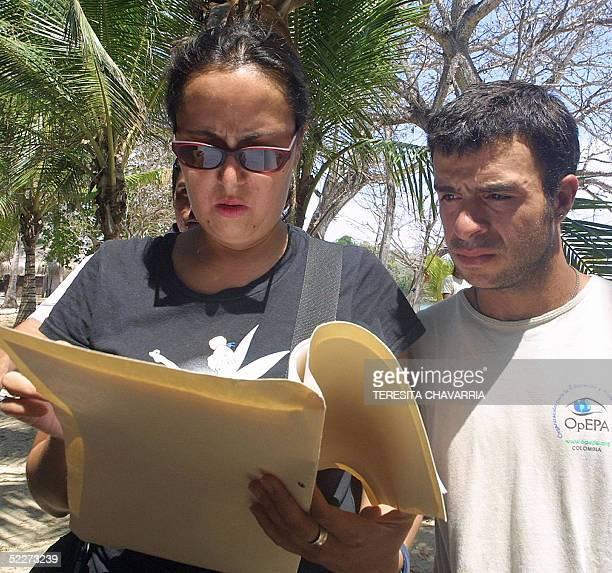 La colombiana Lilliana Andrade productora ejecutiva y otra persona que no quiso identificarse de la compania Teleset leen una orden de secuestro de...