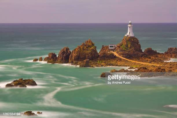 la corbiere lighthouse, jersey, united kingdom - island stock pictures, royalty-free photos & images