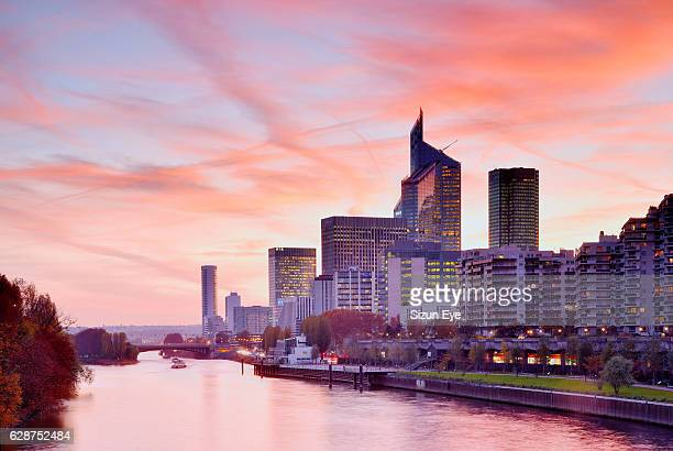La Défense, the business district of Paris and Courbevoie city along the Seine River at sunset in France.