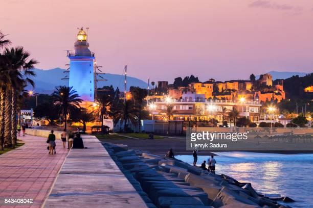 la farola de malaga and alcazaba at sunset - マラガ県 ストックフォトと画像