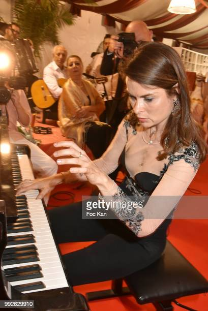 La Femme dans Le Grand Siecle 2018 awarded pianist Natalia Morosova performs during 'La Femme Dans Le Siecle' Dinner on July 5 2018 in Paris France