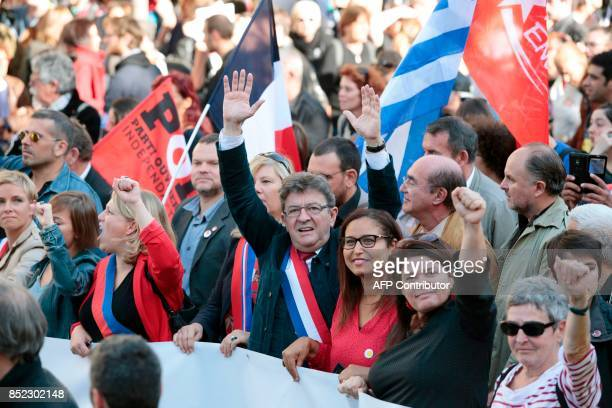 La France Insoumise leftist party parliamentary group President JeanLuc Melenchon flanked by party's spokeperson Raquel Garrido waves during a...
