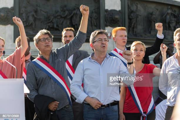 La France Insoumise leftist party's leader and Member of Parliament JeanLuc Melenchon and Francois Ruffin and Eric Coquerel gesture and sing during a...