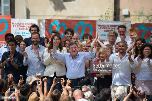 La France Insoumise leftist party's leader and MP Jean-Luc Melenchon sings the national anthem after giving a speech on the last day of the LFI...