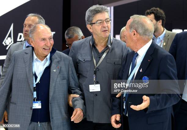 La France Insoumise leftist party's leader JeanLuc Melenchon holds the arm of Chairperson of the Dassault Group and French senator Serge Dassault as...