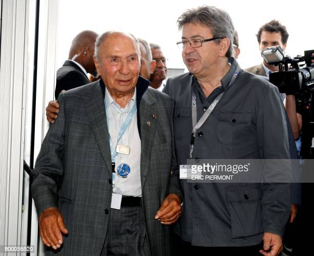 La France Insoumise leftist party's members of parliament, party leader Jean-Luc Melenchon talks with Chairman of Dassault Group Serge Dassault at Le...
