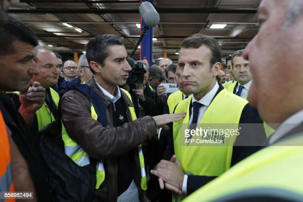La France Insoumise leftist party's MP Francois Ruffin gestures as he speaks to French President Emmanuel Macron during a visit to the Whirlpool...