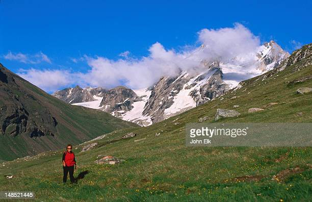la grand sassiere natural reserve, hiker in foreground. - savoie stock pictures, royalty-free photos & images