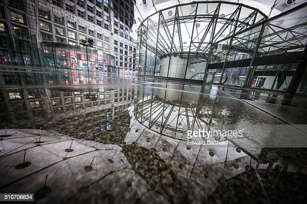 La Grande Arche de la Defense reflecting into a puddle on February 13 2016 in Paris La Defense France