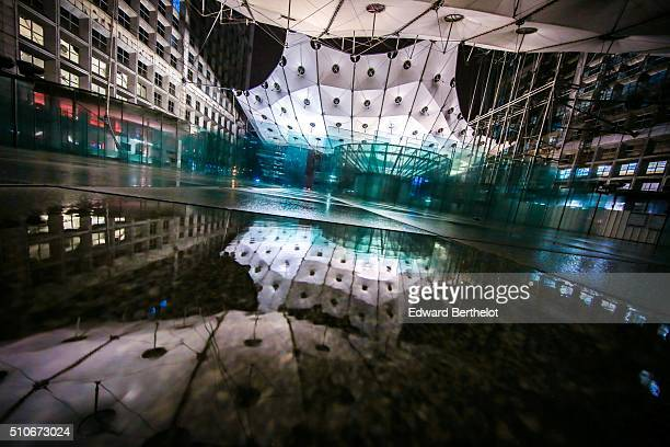 La Grande Arche de la Defense reflecting into a puddle on February 5 2016 in Paris La Defense France