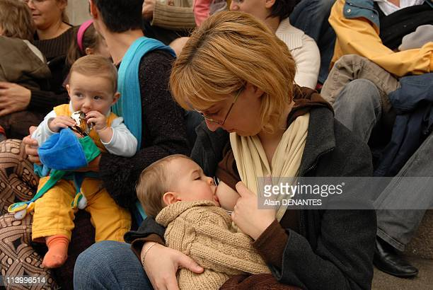 'La Grande Telee' in public gathering the women giving the breast to their babies at the same time to promote for breastfeeding In Nantes France On...