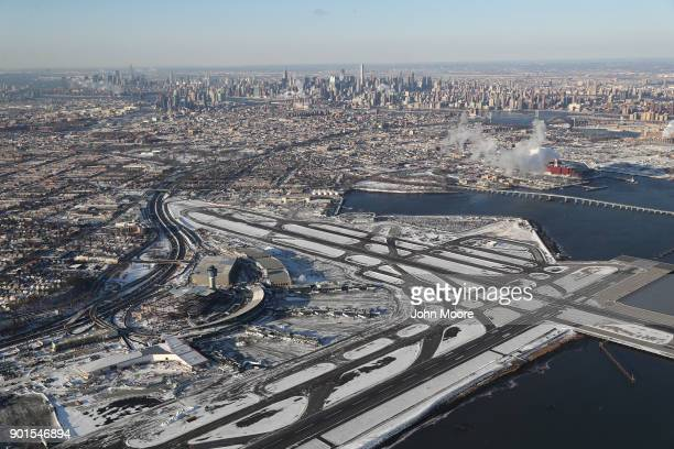 La Guardia Airport awaits arriving flights after runways were plowed of snow on January 5, 2018 in the Queens borough of New York City. Under frigid...