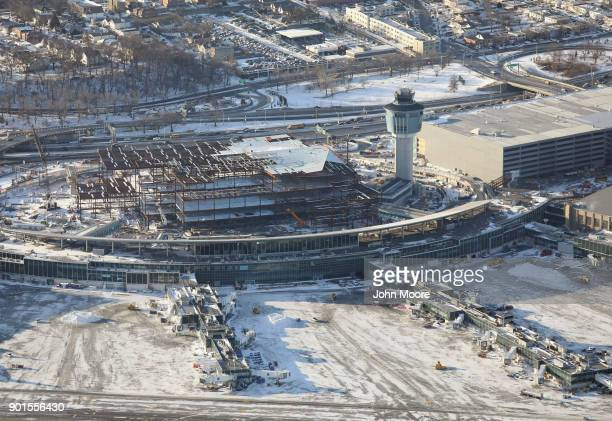 La Guardia Airport still under remodeling awaits arriving flights after runways were plowed of snow on January 5 2018 in the Queens borough of New...