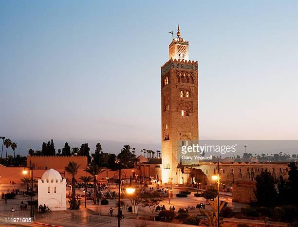 la koutoubia minaret at dusk - international landmark stock pictures, royalty-free photos & images