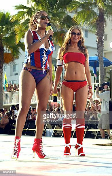 La La and actress Carmen Electra appear during a taping for MTV Spring Break 2003 at the Surfcomber Hotel March 12 2003 in Miami Beach Florida