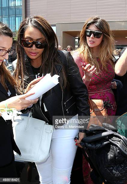 La La Anthony and Brittny Gastineau arrive at Florence Airport before the Kanye West wedding to Kim Kardashian on May 24 2014 in Florence Italy