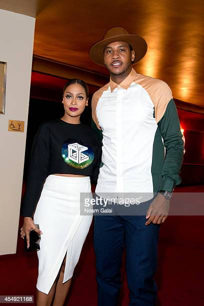 La La Anthony and Carmelo Anthony attend the Opening Ceremony fashion show during MercedesBenz Fashion Week Spring 2015 on September 7 2014 in New...