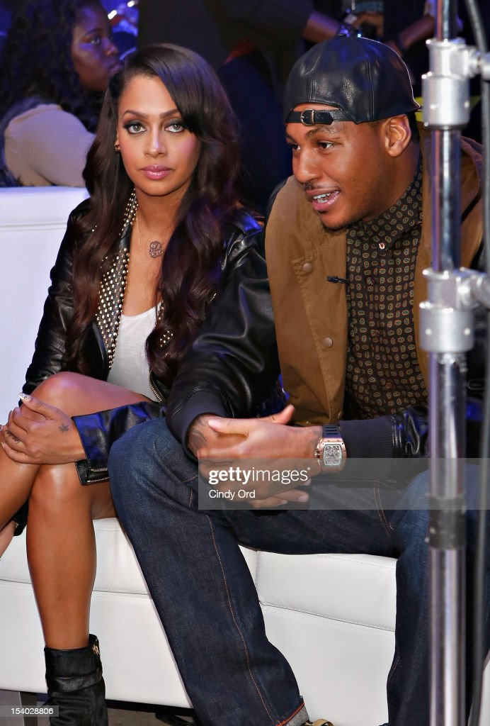 La La Anthony and Carmelo Anthony attend the Rookie USA Flagship Store Opening at Rookie USA on October 12, 2012 in New York City.