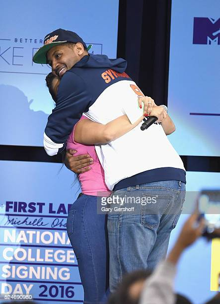La La Anthony and Carmelo Anthony share a hug on stage during the 3rd Annual College Signing Day at the Harlem Armory on April 26 2016 in New York...