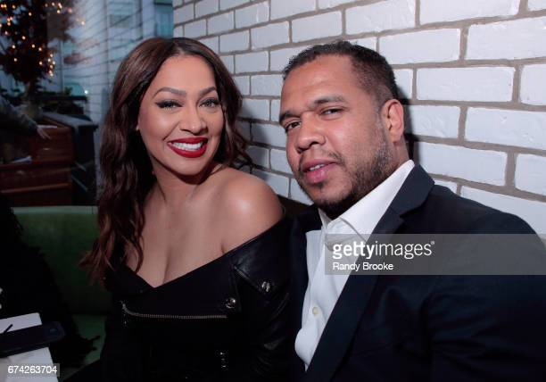 La La Anthony and Johnny Nunez pose during The STARZ Network 'Power' Cocktail Media Event at Catch NYC on April 27 2017 in New York City