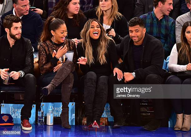 La La Anthony Ciara and Russell Wilson attend the Washington Wizards vs New York Knicks game at Madison Square Garden on February 9 2016 in New York...