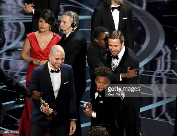 'La La Land' producer Fred Berger smiles with actors Jaden Piner Ashton Sanders and Ryan Gosling onstage following the error regarding an erroneous...
