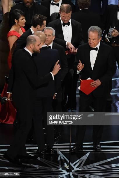 'La La Land' producer Jordan Horowitz celebrates next to US actor Warren Beatty after the latter mistakingly read 'La La Land' initially instead of...