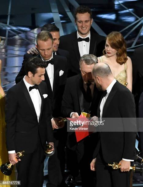 'La La Land' producer Jordan Horowitz consults with production staffer regarding a presentation error of the Best Picture award as composers Justin...