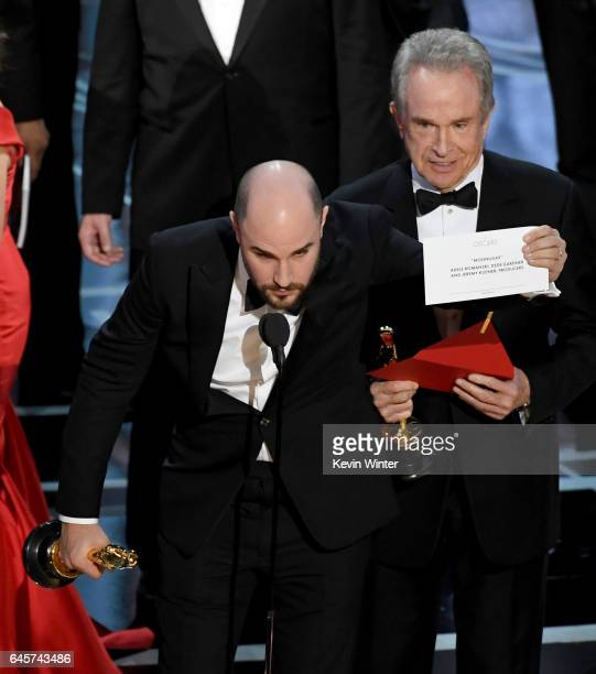 'La La Land' producer Jordan Horowitz holds up the winner card reading actual Best Picture winner 'Moonlight' after a presentation error with actor...