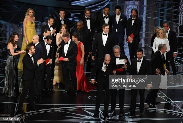 La La Land producer Jordan Horowitz shows the card saying Moonlight won the best picture as actor Warren Beatty and Host Jimmy Kimmel look on at the...