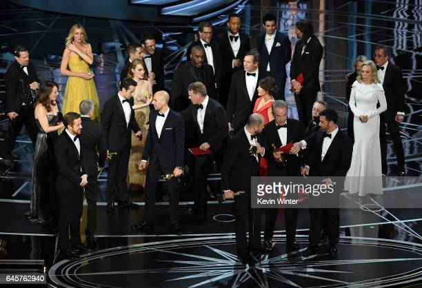 'La La Land' producer Jordan Horowitz speaks while holding an Oscar and the winner card before reading the actual Best Picture winner 'Moonlight'...