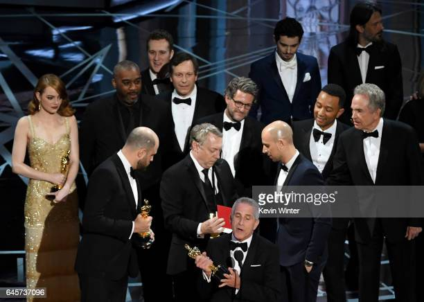 'La La Land' producer Marc Platt speaks with producers Jordan Horowitz and Fred Berger as production staff consult behind them regarding a...