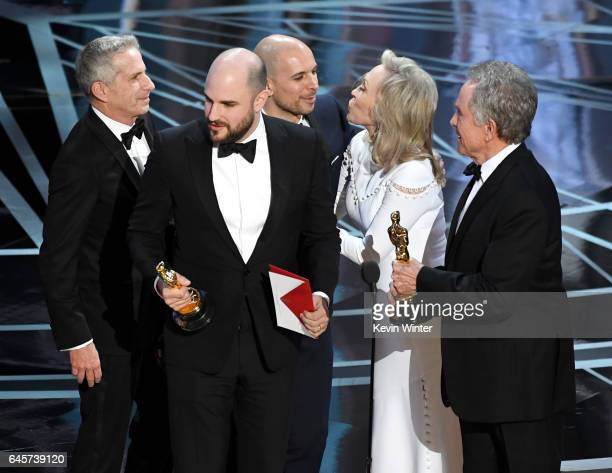 La La Land' producers Fred Berger, Jordan Horowitz and Marc Platt accept the Best Picture award due to a presentation error from actors Faye Dunaway...