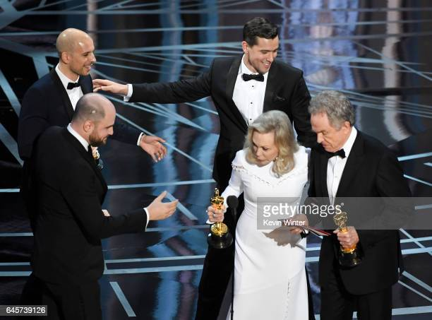 ''La La Land' producers Fred Berger Jordan Horowitz and Marc Platt accept the Best Picture award due to a presentation error from actors Faye Dunaway...