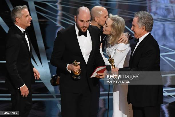 La La Land producers Marc Platt Jordan Horowitz and Fred Berger accept their awards for best picture from US actors Faye Dunaway and Warren Beatty...
