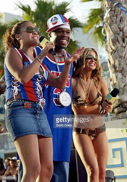 MTV VJ La la rapper 50 Cent and Carmen Electra appear during a taping for MTV Spring Break 2003 at the Surfcomber Hotel March 12 2003 in Miami Beach...