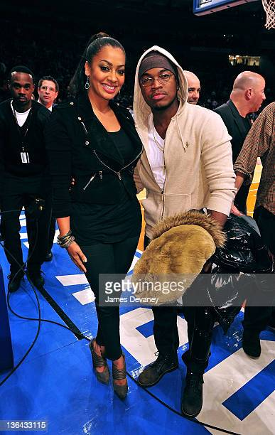 La La Vazquez and NeYo attend the Charlotte Bobcats vs the New York Knicks game at Madison Square Garden on January 4 2012 in New York City