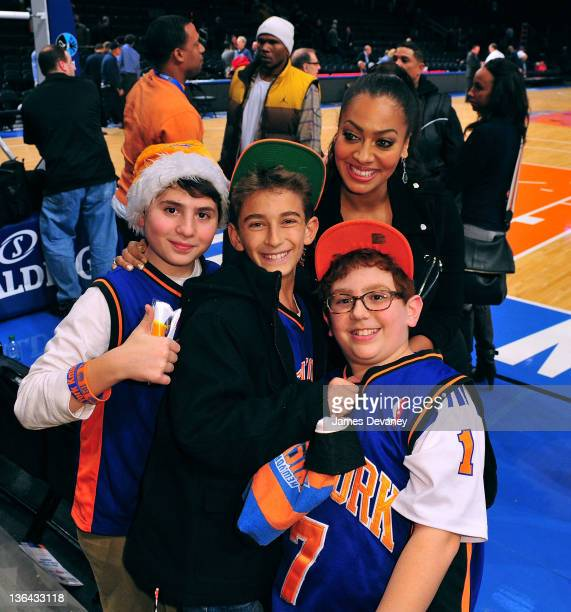 La La Vazquez poses with fans at the Charlotte Bobcats vs the New York Knicks game at Madison Square Garden on January 4 2012 in New York City