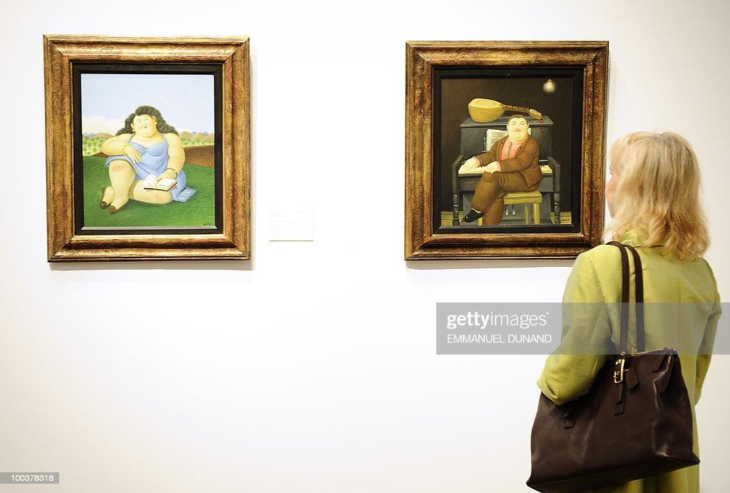 'La Lectora' (L) and 'Man at the Piano' by Fernando Botero are on display during a preview of Christie's Latin American Art auctions, May 24, 2010 in New York. Christie's will hold its Latin American Art auctions on May 26 and 27, 2010. AFP PHOTO/Emmanuel Dunand