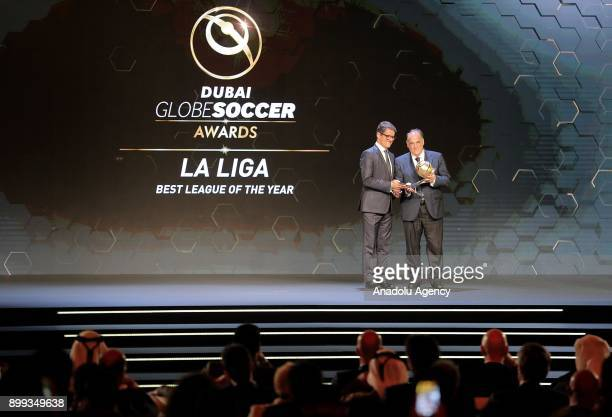La Liga President Javier Tebas receives 'Best League of the Year' award from former football player Fabio Capello during the Globe Soccer Awards...
