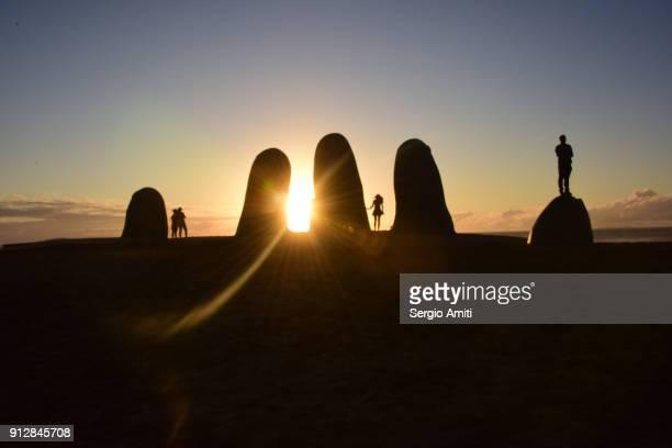 La Mano de Punta del Este at sunset