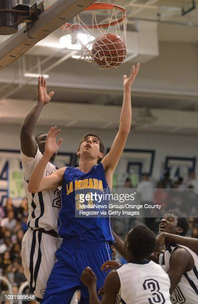 LAKEWOOD CALIF USA La Mirada's Charlie Reid and Mayfair's Brandon Reynolds go after a rebound in Lakewood Calif on February 8 2013 Mayfair defeated...