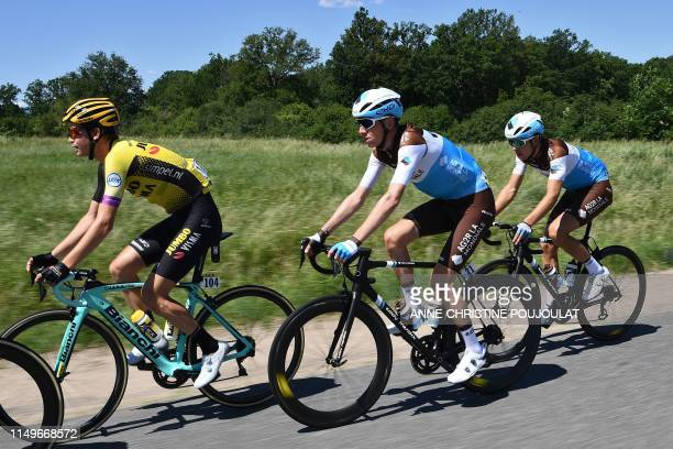 La Mondiale rider France's Romain Bardet rides in the pack with a teammate and Team JumboVismarider US Sepp Kuss during the fifth stage of the 71st...