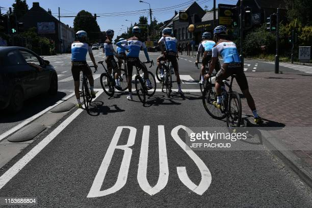 La Mondiale riders wait at a junction during a training session near Brussels on July 4 two days prior to the start of the 106th edition of the Tour...