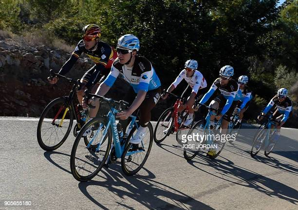 La Mondiale's Belgian cyclist Oliver Naesen and Swiss cyclists Cyril Gautier Silvan Dillier and Axel Domont ride with teammates during a training in...